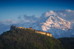 Rasnov Citadel. Historic monument and landmark in Romania against high mountain in a sunset light stock images