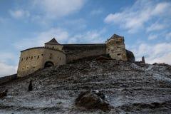 Rasnov Citadel. Râșnov Citadel (Romanian: Cetatea Râșnov, German: Rosenauer Burg) is a historic monument and landmark in Romania. It is situated in Râşnov Stock Photography