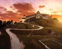 Sunset at Rasnov medieval citadel in Transylvania. Rasnov medieval citadel in Transylvania in dramatic sunset light royalty free stock image
