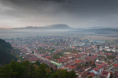 Rasnov. Town, houses and mountains landscape Stock Photos