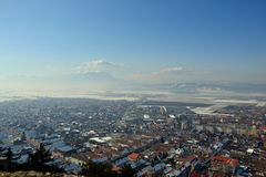 Rasnov. Town, houses and mountains landscape Royalty Free Stock Photo