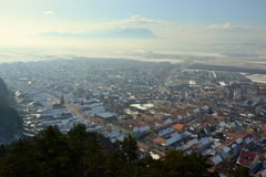 Rasnov. Town, houses and mountains landscape Royalty Free Stock Photography