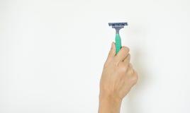 Rasoir ou rasoir à disposition sur le fond Photos stock