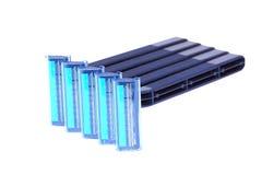 Rasoirs jetables en plastique personnels bleus d'isolement Images libres de droits