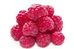 Raspberries. Pile of raspberries isolated over white background macro shot Stock Photo
