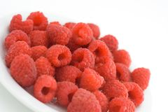 Raspberries. On a plate stock photos