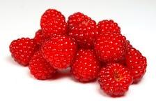 Raspberries. Macro photo of red fruit isolated on white Royalty Free Stock Photo