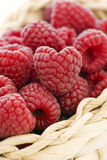 Raspberries. As closeup in a basket Royalty Free Stock Image