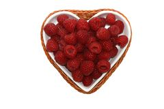 Raspberries. Raspberrie in the bowl in the form of heart Royalty Free Stock Photos
