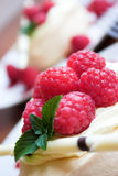 Raspberries!!!. Close up of raspberries atop of a pavlova dessert Royalty Free Stock Photography