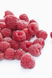 Raspberries. Fresh ripe raspberries on a white background stock image