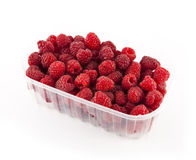 Raspberries. Ripe, juicy raspberries in a transparent plastic container on a white background Royalty Free Stock Photo