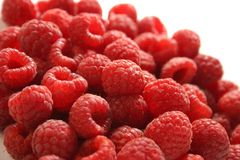 Raspberries. A lot of raspberries on a white studio background Stock Photo
