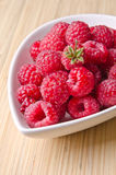 Raspberries. Fresh and natural raspberries in a white bowl Stock Photography