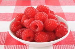 Raspberries. A small bowl of raspberries on a picnic table Stock Images
