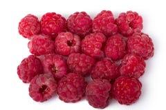 Raspberries. Ripe red raspberries isolated on white background Stock Photos