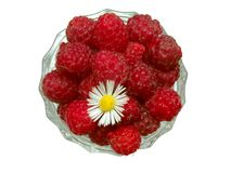 Raspberries 5. Top view of raspberries in the glass jam dish with camomile royalty free stock photography