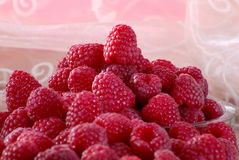 Raspberries. Raw raspberries in front of a pink background Royalty Free Stock Images