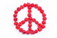 Raspberries arranged in the shape of the symbol of. Fresh raspberries arranged in the shape of the hippies peace symbol  isolated on white background Stock Image