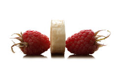 Raspberries and banana. Two red raspberry and banana between them Stock Photos