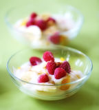 Raspberries, banana and cream Royalty Free Stock Photography