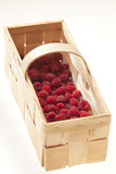 Raspberries in basket Stock Photos