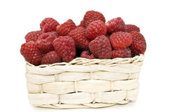 Raspberries in a basket. Bright, fresh raspberries in a basket on a white background Stock Image