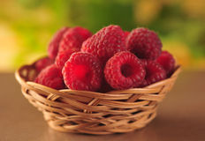 Raspberries in the basket. On the table Royalty Free Stock Photography
