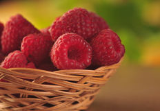 Raspberries in the basket. On the table Stock Image