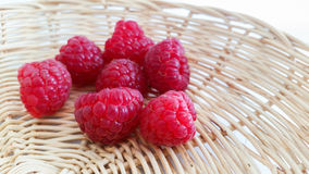 Raspberries in basket. Fresh raspberries in basket background Stock Photos