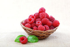 Raspberries in a basket on a homespun cloth Stock Images