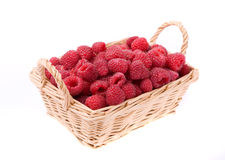 Raspberries in the basket isolated on white. Fresh raspberries in the wicker basket cut out isolated on white Royalty Free Stock Image