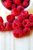 Raspberries in a basket on  table. Raspberries in a basket on wooden table Royalty Free Stock Photos