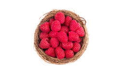 Raspberries in a basket on white background. Top view Royalty Free Stock Photography