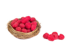 Raspberries in a basket on white background. Top view Royalty Free Stock Photo