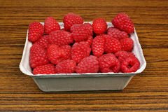 Raspberries in baskets on the table Royalty Free Stock Photos