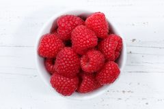 Raspberries berries from above bowl wooden board Stock Photos