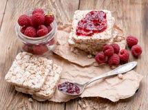 Raspberries berries, raspberries jam,bread on wooden table. Breakfast healthy eating Royalty Free Stock Photography