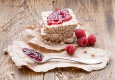 Raspberries berries, raspberries jam,bread on wooden table. Breakfast healthy eating. Raspberries berries, raspberries jam,bread on wooden table. Breakfast with Stock Images