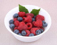 Raspberries and berry on a bowl. Fresh raspberries and berry on a bowl Stock Photo