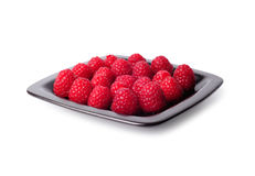 Raspberries on a black plate Royalty Free Stock Images
