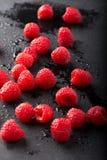 Raspberries on Black Slate Stock Photo