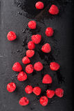 Raspberries on Black Slate Stock Image