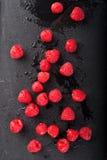 Raspberries on Black Slate Stock Image