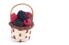 Raspberries and blackberries basket Royalty Free Stock Photography