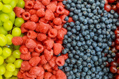 Raspberries, blackberries, blueberries a gray abstract background. Copyspace. Healthy food concept. Stock Photography
