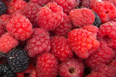 Raspberries and blackberries close up. Fresh seasonal raspberries and blackberries close up Stock Photography