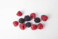 Raspberries and Blackberries. With isolated white background Royalty Free Stock Images