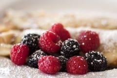 Raspberries, blackberries and pancakes Stock Photo