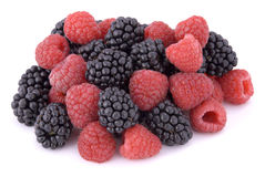 Raspberries and blackberries. On white background Royalty Free Stock Photography
